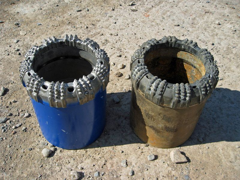 A new drill head (left) and the one used here (right) after the borehole had been completed.